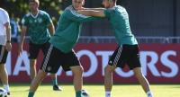 Germany's defender Niklas Suele (L) and Germany's midfielder Leon Goretzka (R) warm up during a training session in Vatutinki.
