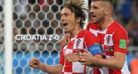 Croatia's midfielder Luka Modric (L) celebrates scoring a penalty with his teammate forward Ante Rebic during the Russia 2018 World Cup Group D football match between Croatia and Nigeria at the Kaliningrad Stadium in Kaliningrad on June 16, 2018.