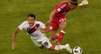 Denmark's forward Yussuf Poulsen (R) challenges Peru's midfielder Yoshimar Yotun (L) during the Russia 2018 World Cup Group C football match between Peru and Denmark at the Mordovia Arena in Saransk on June 16, 2018. / AFP PHOTO