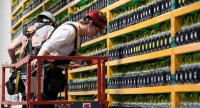 In this file photo taken on March 19, 2018 Two construction workers inspect the area at the bitcoin mining company Bifarms in Saint Hyacinthe, Quebec, on March 19, 2018./AFP