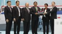 Celebrating the roll out of the first of the new trains from a plant in Turkey are executives of Bangkok Metropolitan Administration, Bangkok Mass Transit System Plc, Siemens and Bozankaya.