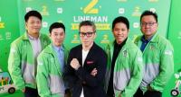 Ariya Banomyong, managing director of Line Thailand, centre, with his team leaders for the Line Man operation.