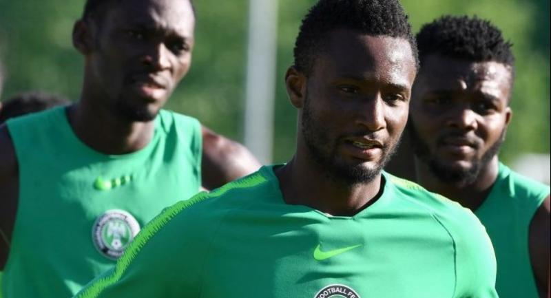 Nigeria's midfielder John Obi Mikel (C) attends with team-mates a training session at Essentuki Arena in southern Russia on June 20, 2018 during the Russia 2018 World Cup football tournament.