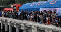 Family members attend a prayer for their missing relatives, victims of a ferry that capsized on June 18, at Lake Toba ferry port in the province of North Sumatra on June 21.//AFP