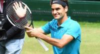 Roger Federer of Switzerland celebrates after defeating Denis Kudla from the US in their match at the ATP tennis tournament in Halle, western Germany, on June 23, 2018.  CARMEN JASPERSEN / AFP