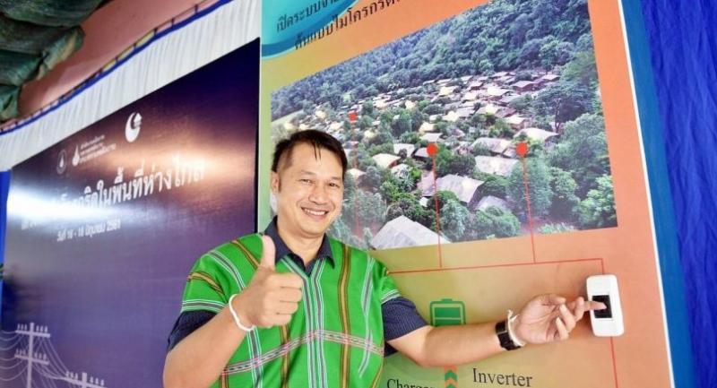 Dr Twarath Sutabutr flips the microgrid switch at Pha Dan community in Mae Tha district, Lamphun province.