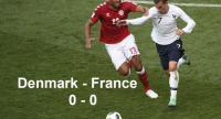 Denmark's defender Mathias Jorgensen (L) vies for the ball with France's forward Antoine Griezmann.
