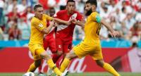 Peru's midfielder Christian Cueva (C) vies for the ball with Australia's midfielder Mile Jedinak (R) and Australia's defender Mark Milligan (L) .