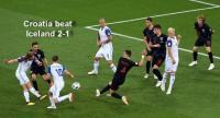 celand's midfielder Birkir Bjarnason (L) kicks the ball in an attempt to score during the Russia 2018 World Cup Group D football match.