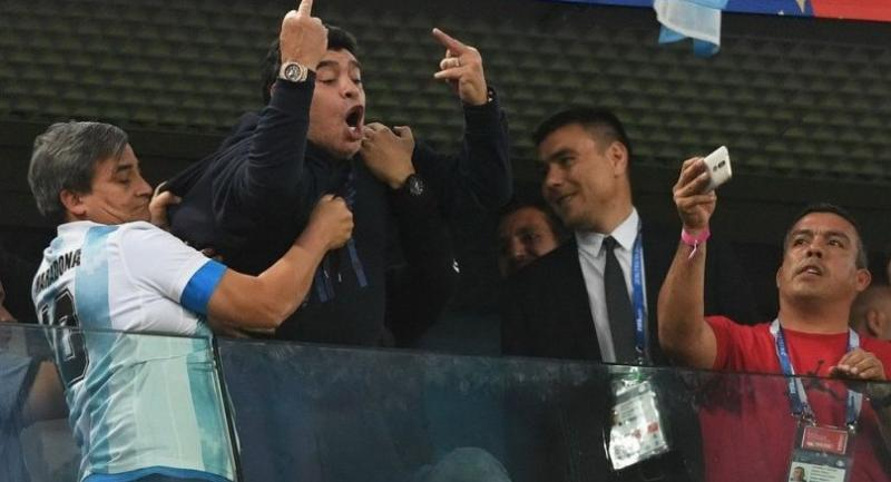 Retired Argentina player Diego Maradona (C) gestures during the Russia 2018 World Cup Group D football match between Nigeria and Argentina at the Saint Petersburg Stadium.