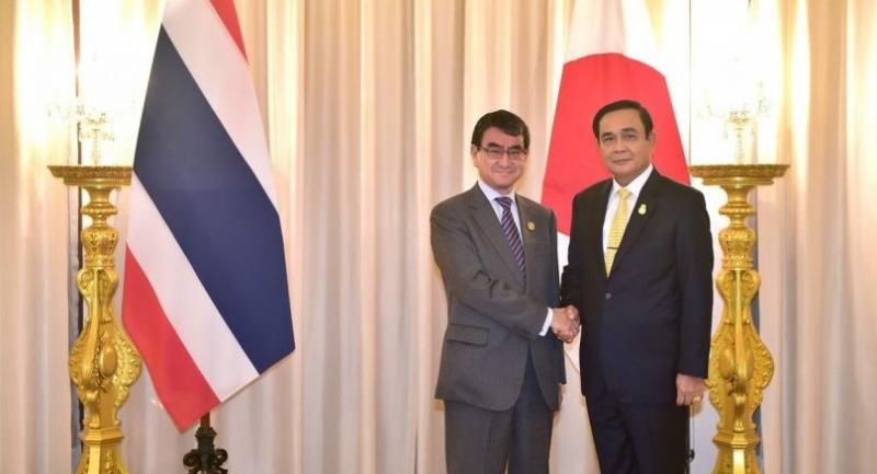 Japanese Foreign Minister Taro Kono with Prime Minister Prayut Chan-o-cha at Government House on Wednesday.