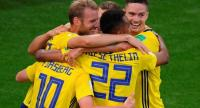 Sweden's players celebrate after Mexico's defender Edson Alvarez scored an own goal for 0-3.