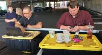 Capital Gazette reporter Chase Cook (R) and photographer Joshua McKerrow (L) work on the next day's newspaper while awaiting news from their colleagues in Annapolis, Maryland, June 28.//AFP