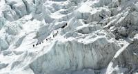Climbers cross the Khumbu icefall of Mount Everest, as seen from the Everest base camp earlier this year. /AFP