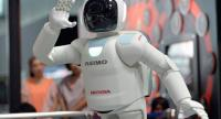 Launched in 2000, Asimo, which resembles a shrunken spaceman, has become Japan's most famous robot, wheeled out to impress visiting politicians over the years. /AFP