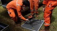PTT personnel prepare a thermal imaging drone during the rescue operation for a missing children's football team and their coach in Tham Luang cave. // AFP PHOTO