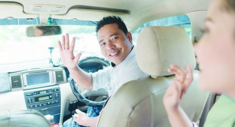 Taxi driver at a Grab event for partners in Yangon.