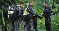 Australian divers helping in the rescue mission congratulate the Thai navy Seal rescuers after the missing boys and their football coach were found on Monday night.