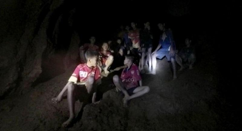 A still from a video of the 13 members of the Mu Pa Academy Mae Sai football club taken by one of the two British divers who located the missing team at a dry spot of the cave on Monday night.