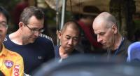 Two British divers John Volanthen (L) and Richard William Stanton (R) are seen with Thai rescue personnel at the Tham Luang cave area at Khun Nam Nang Non Forest Park in the Mae Sai district of Chiang Rai province on July 3, 2018./AFP