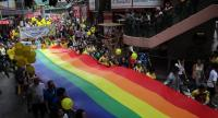 In this file photo taken on November 6, 2015 people take part in the Lesbian, Gay, Bi-sexual and Transgender (LGBT) parade in Hong Kong. // AFP PHOTO