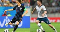 Croatia's midfielder Luka Modric  and Russia's midfielder Aleksandr Golovin