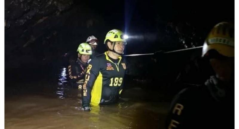 Rescuers continue to work inside Tham Luang cave Friday night.