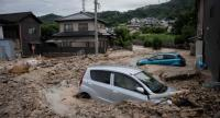 A picture shows cars trapped in the mud after floods in Saka, Hiroshima prefecture on July 8.//AFP