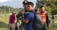 A Thai soldier and a police officer block a photographer during the evacuation operation of a boy with a helicopter to a hospital after he was rescued from the Tham Luang cave, at an air force airport in Chiang Rai province yesterday. //EPA-EFE PHOTO
