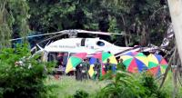 A helicopter is preparing to airlift another survivor of Tham Luang stranding, who had been stranded inside the flooded cave since June 23, to a hospital yesterday.