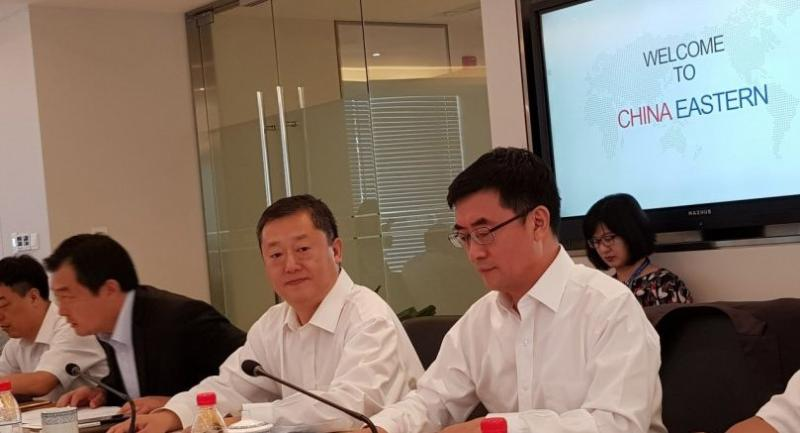 Dong Bo, China Eastern Airlines' chief marketing officer, second from right, speaks to a group of international journalist during a visit to the airline headquarters in Shanghai recently.