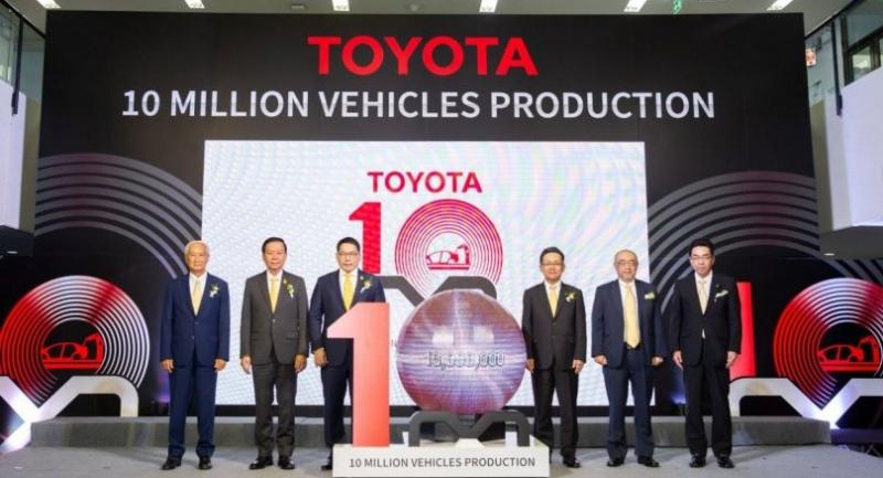 Industry Minister Uttama Savanayana, third left, TMT president Michinobu Sugata, third right, and TMT executives at a ceremony marking the production milestone at its plant in Samrong.