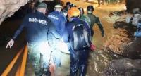 This handout video grab taken from footage released by the Royal Thai Navy on July 11, 2018 shows rescue personnel carrying a member of the