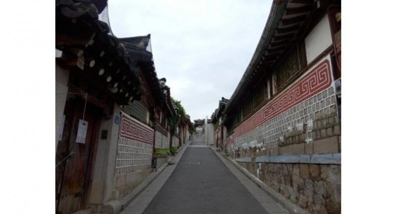 Bukchon Hanok Village is a cluster of homes of classic Korean design.