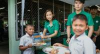 Salinla Seehaphan, corporate affairs director of Tesco Lotus joins her colleagues in Kalasin to prepare lunch for students at Non Sila Krai Rerk Rat Amnuay in the province. Kalasin is one of the 10 poorest provinces in Thailand.