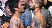 Philippines' Manny Pacquiao (L) and Argentina's Lucas Matthysse pose for pictures after the weigh-in event in Kuala Lumpur on July 14, 2018, ahead of his world welterweight boxing championship bout against Pacquiao on July 15. / AFP