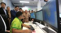 Deputy Prime Minister Chatchai Sarikulya, standing third left, inspects a fishery monitoring centre on Monday.