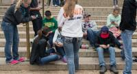 In this file photo taken on April 8, 2015 a group of teens check their smartphones outside the Natural History Museum in Washington,DC. /AFP