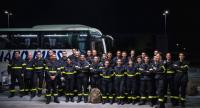 French civil protection service soldiers experts in fire-fighting pose for a picture after arriving to Arlanda airport, north of Stockholm on July 23, 2018./AFP