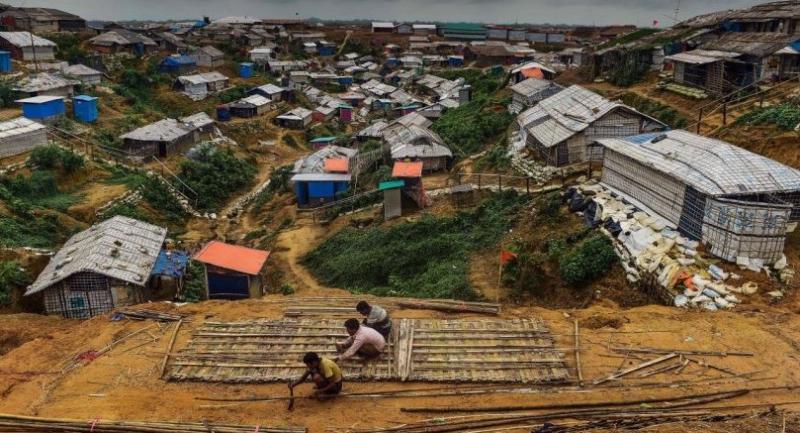 Rohingya refugees use bamboo to build a shelter at Balukhali refugee camp in Ukhia on July 21, 2018.