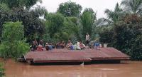 Lao villagers are stranded on a roof of a house after they evacuated floodwaters after the Xe Pian Xe Nam Noy dam collapsed in a village near Attapeu province, Laos on July 24.//EPA-EFE
