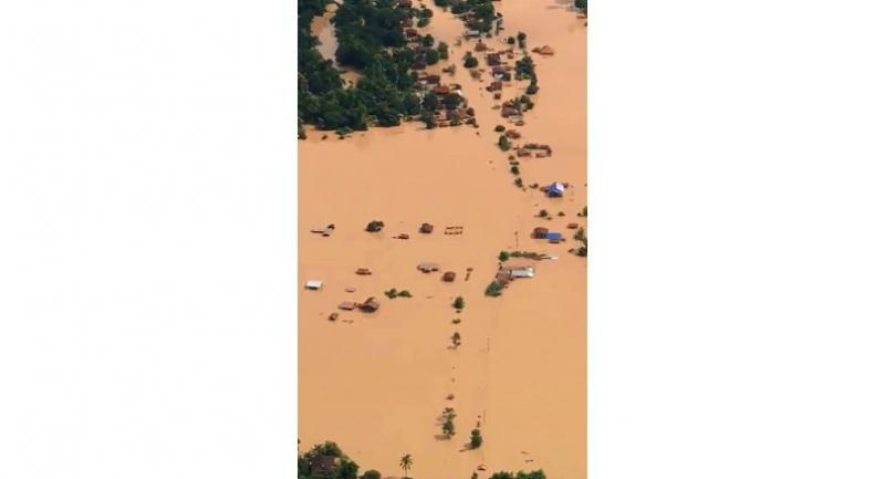 This screen grab taken on handout video footage from ABC Laos on July 24, 2018 shows an aerial view of the flooded plains in Attapeu province after a dam collapsed the day before./AFP