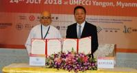 Myo Thet, left, vice president of the Union of Myanmar Federation of Commerce and Industry, with Cheng Tien Chan, vice chairman of the Chinese National Federation of Industries, after the signings of MoU between the two group.