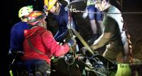 A Thai Navy SEALs photo from inside the cave, shows the rescuers hoisting one of the football team members to safety from the Tham Luang cave. The drama of life-saving rescue has attracted  film and TV companies.