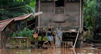 This picture taken on July 27, 2018 shows a resident returning to his home from Sanamxai district, Attapeu province, after floodwaters from a dam collapse had receded./AFP