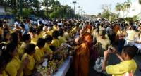 Locals give alms to Buddhist monks to celebrate the 66th birthday of the king of Thailand, His Majesty Maha Vajiralongkorn, in the southern Thai province of Narathiwat on July 28, 2018. / AFP PHOTO / Madaree TOHLALA