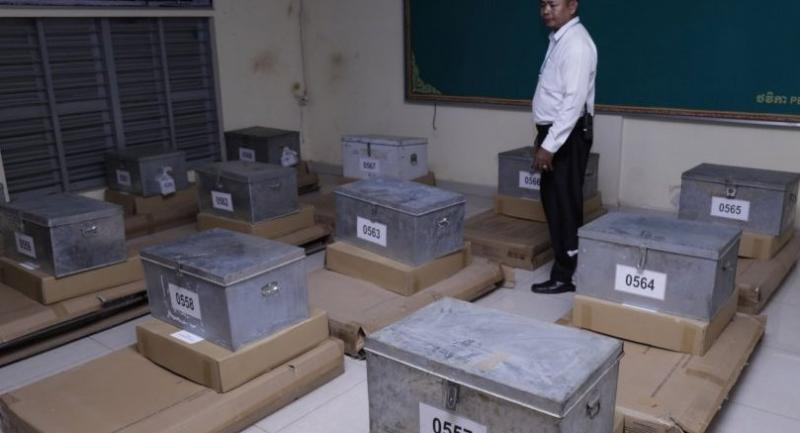 A Cambodian National Election Committee official inspects ballot boxes as he prepares for the upcoming national elections at a polling station in Phnom Penh, Cambodia on July 28.//EPA-EFE