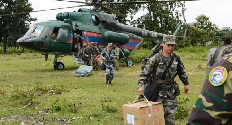 A Chinese People's Liberation Army medical team arrives at the flooded-area in Attapeu, Laos, on Thursday. [Photo/Xinhua]