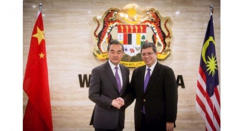 Saifuddin (right) with China's Wang Yi at Wisma Putra in Putrajaya on July 31, 2018. - MOHD SAHAR MISNI/The Star
