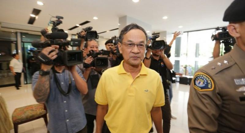 Former director of the National Buddhism Office Phanom Sornsilp is brought for questioning to the Crime Suppression Division head office in Bangkok.